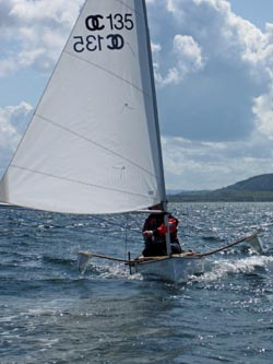 sailing canoe in sound of mull