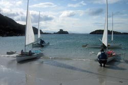 sailing canoes landing on beach