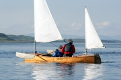 wooden sailing canoe with bermudan ketch rig
