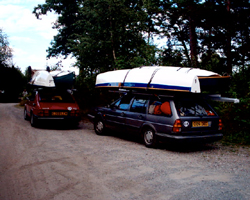 Four sailing canoes on two cars